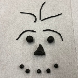 Funny face created with pieces of hashish